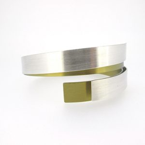vanessa-williams-titanium-bangle-gold