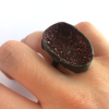 Coming from nothing crushed garnet ring