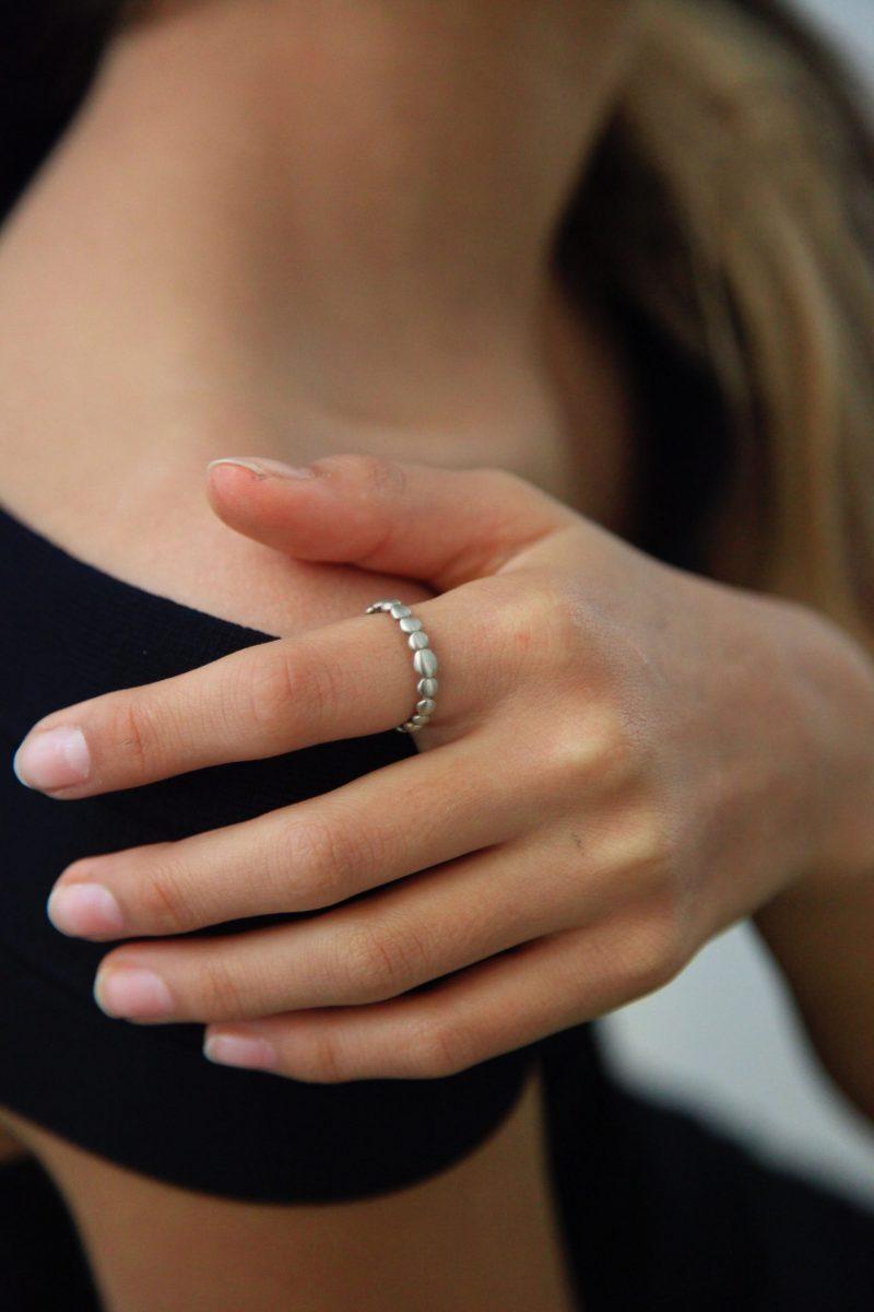 white gold dot ring on finger