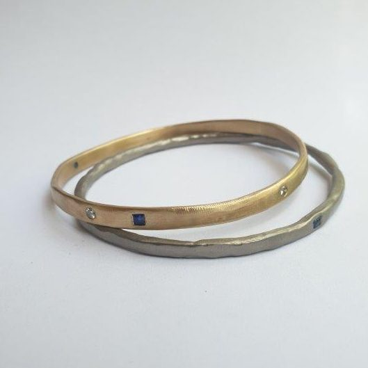 Finished organic style bangles with 'making' marks to honour the handmade process