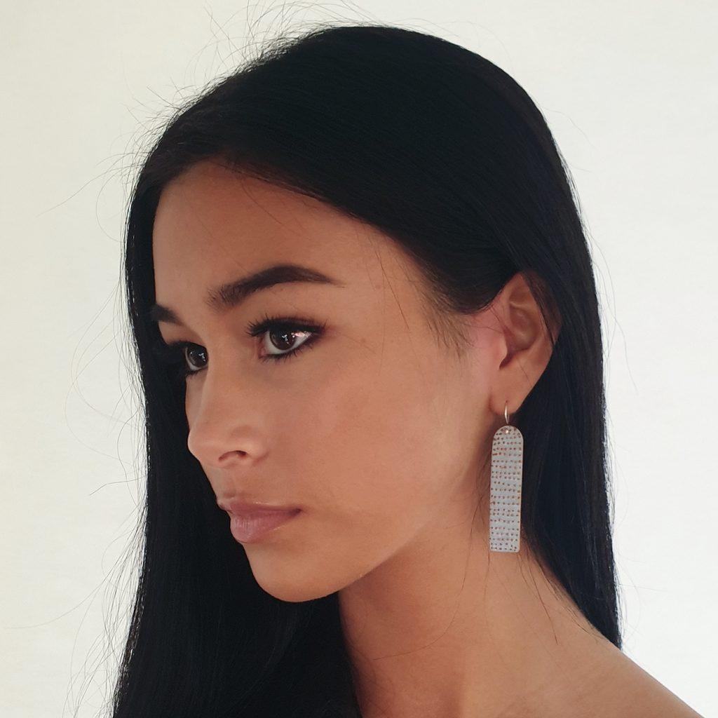 blue going dotty drop earrings on model