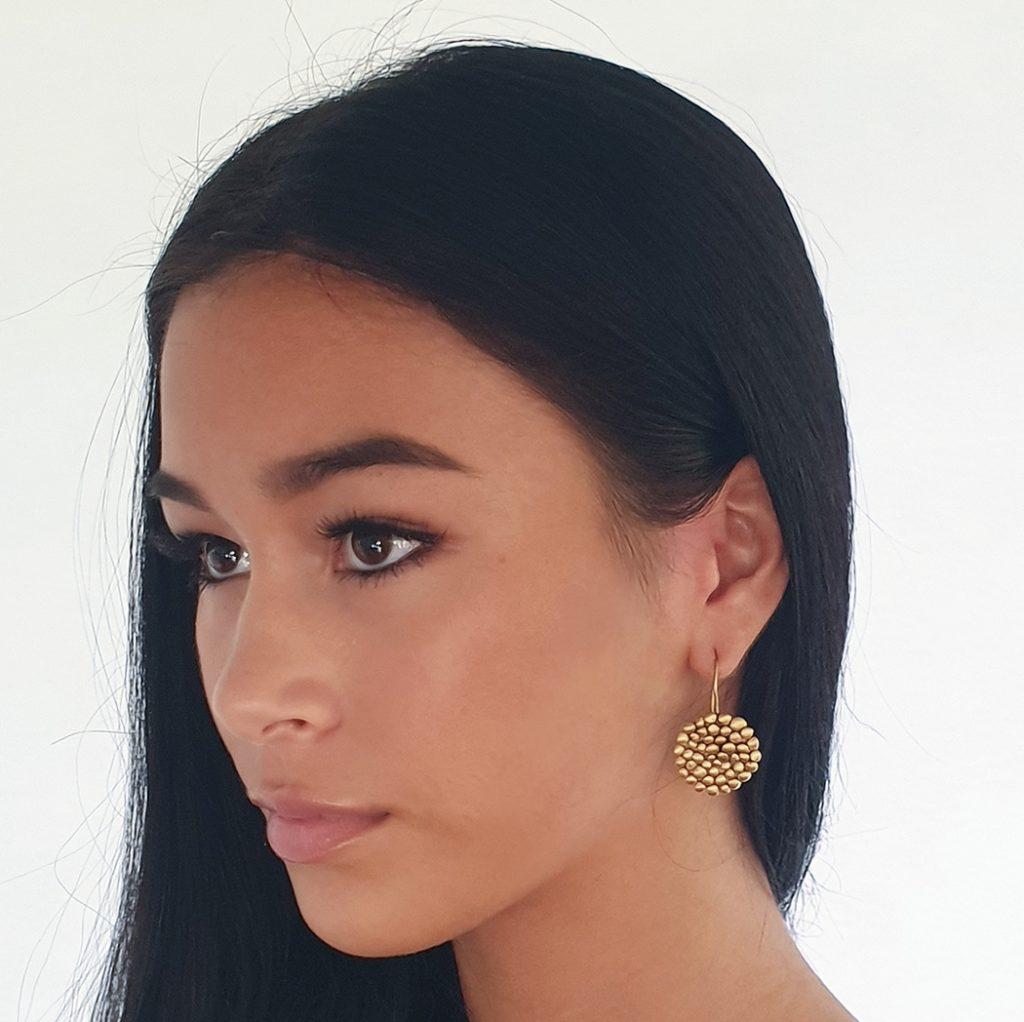 gold drop pebble earrings on
