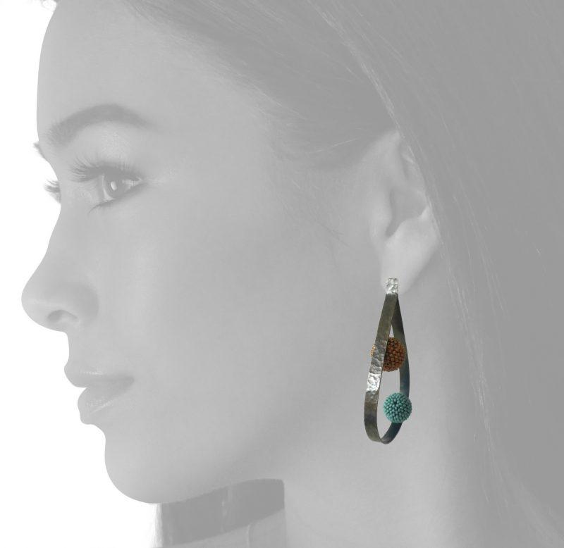 loop blue ball earrings on the body